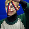 Record-Eagle/Jan-Michael Stump<br /> Dylan Fryman celebrates his gold medal following the Special Olympics speed skating finals Thursday at Howe Arena.