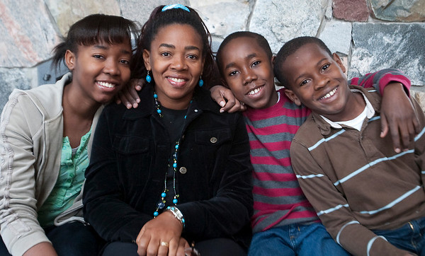 Record-Eagle/Douglas Tesner<br /> Marcia Petit-Frere and her three children Sara, 16, Jason, 14, and Matthew, 10, all are from Haiti.