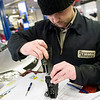 Record-Eagle/Jan-Michael Stump<br /> Toyota technician Jake Courtad installs a reinforcement bar behind the gas pedal of a 2009 Corolla on Thursday at Traverse Motors.