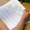 Record-Eagle/Douglas Tesner<br /> Caroline Kitts, a kindergartner, works on a writing assignment at Courtade Elementary.