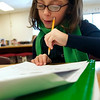 Record-Eagle/Douglas Tesner<br /> Haley Nemec-Dimarzo works on a writing assignment at Courtade Elementary.
