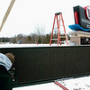 Record-Eagle/Douglas Tesner<br /> Jeff Orton and his son Josh install a new sign at the entrance to the planned YMCA off Silver Lake Road. The Ortons own the company doing the work, Attitude & Experience Signs & Service. Fundraising efforts continue for the new facility, with construction set to begin once the campaign has yielded $11.2 million in donations and pledges.