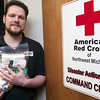 Record-Eagle/Douglas Tesner<br /> Kevin Bavers, executive director of the American Red Cross holds several kits they give out to people needing assistance. The American Red Cross received a $17,600 grant from the Grand Traverse Band of Ottawa and Chippewa Indians on Wednesday.