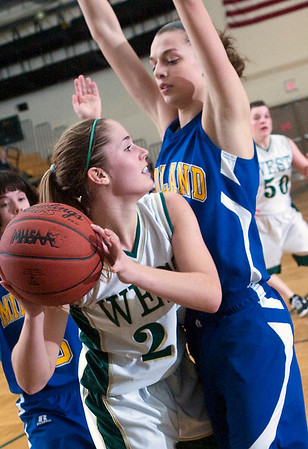 Record-Eagle/Douglas Tesner<br /> Traverse City West's Mallory Litwiller is guarded by Midland's Maura McAfee as she looks to pass in Tuesday's non-conference game won by the Chemics.