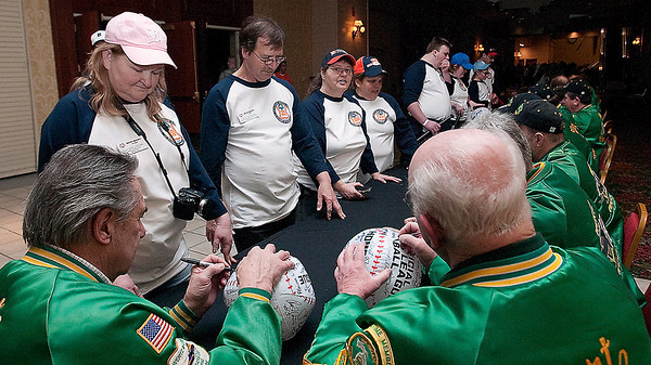 Record-Eagle/Douglas Tesner<br /> Wertz Warriors sign autographs for area director Alainna Loehne and her Special Olympics athletes at the 2010 State Winter Games before opening ceremonies at the Grand Traverse Resort & Spa.