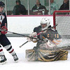 Record-Eagle/Douglas Tesner<br /> Cadillac goalie Mike Boike stops a shot by the Reps Jake Peacock in the Vikings 3-0 win at Centre ICE.