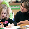 Record-Eagle/Douglas Tesner<br /> Kindergarten teacher Kristen Schoonover works with Summer Anderson at Courtade Elementary. Traverse City Area Public Schools is considering adding all-day, every-day kindergarten to all elementary schools next year. Students at Courtade already have the full-time program.