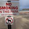 Record-Eagle/Vanessa McCray<br /> Signs at Bryant Park, along West Grand Traverse Bay, inform visitors of a no-smoking ordinance.