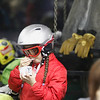 Record-Eagle/Jan-Michael Stump<br /> Veda Joynt, 8, has some of the free ice cream handed out in the Hickory Hills lodge Thursday as part of the ski hill's 60th anniversary celebration.