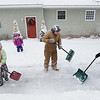 Record-Eagle/Keith King<br /> Mary Coon, right, of Traverse City, and her husband, Ron, finish shoveling the sidewalk near their home Friday as their granddaughters, Ella Smith, 7, left, helps out and Rena Smith, 4, in back, stands near for support.