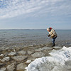 """Record-Eagle/Keith King<br /> Jerry Byville, of Elk Rapids, searches for rocks and slag Wednesday, January 11, 2012 in East Grand Traverse Bay in Elk Rapids so that he can use them to make jewelry, include them in lighthouses he makes and """"whatever I can invent,"""" Byville said. """"It's one of those days you just don't get; a week ago there was ice here and now it's broken up,"""" Byville said."""