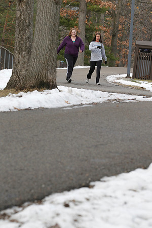 Record-Eagle/Jan-Michael Stump<br /> Nancy Caldwell, left, and Katie Riling enjoy each other's company as they traverse the Civic Center's popular pathway.