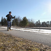 """Record-Eagle/Keith King<br /> Lou Platteborze, of Traverse City, takes advantage of the weather as he skates down a section of the TART Trails along Parsons Road on Tuesday. """"I'd like some snow; I think we've got it coming,"""" said Platteborze."""