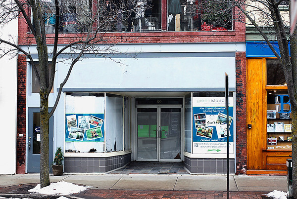 Record-Eagle/Jan-Michael Stump<br /> Green Island, currently at 118 S. Union St, is moving to 120 East Front St., seen here.