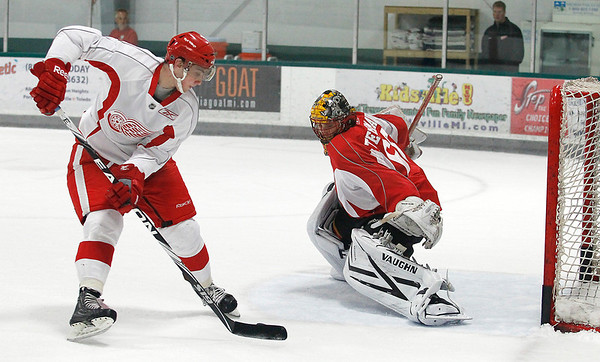 Record-Eagle/Jan-Michael Stump<br />  Tyson Teichmann stops Tomas Jurco during a shoot out in Detroit Red Wings Development Camp Thursday at Centre ICE.