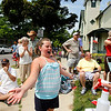 Record-Eagle/Jan-Michael Stump<br /> Isabella Wicksall, 8, gets sprayed with water by Kristen Domine from the Traverse City St. Francis Gladiator Band during the Cherry Royale Parade Saturday.