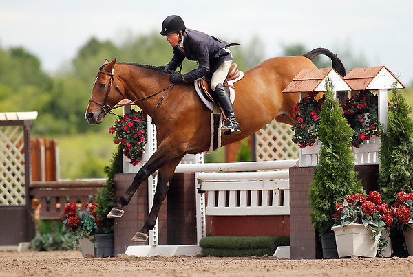 Record-Eagle/Jan-Michael Stump Peter Pletcher rides Lacosté in the Horse Shows by the Bay Three-Foot-Three Performance Hunter competition Thursday in Williamsburg.