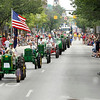 Record-Eagle/Jan-Michael Stump<br /> The Great Lakes Antique Tractor Club makes its way down Front Street during the Cherry Royale Parade Saturday.
