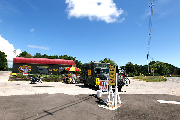 Record-Eagle/Jan-Michael Stump<br /> Norbert Tutlis is setting up his hot dog stand at the intersection of Zimmerman and Silver Lake Roads, but is having trouble with the Garfield Township zoning department in getting his business approved.