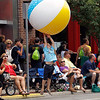Record-Eagle/Jan-Michael Stump<br /> Vin Soffredine, 6, hits a giant beach ball tossed by a float in the Cherry Royale Parade Saturday.