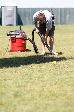 Record-Eagle/Jan-Michael Stump<br /> Matt Haase vacuums broken glass from the grass at the Open Space following a jaws of life demonstration during Hero's Day Monday at the National Cherry Festival.