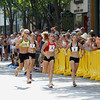 Record-Eagle/Jan-Michael Stump<br /> Runners in the Golden Mile turn make their first trip down Front Street during the race Saturday.