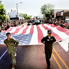 Record-Eagle/Keith King<br /> Members of the United States Coast Guard carry the American Flag down Front Street Saturday during the Cherry Royale Parade.