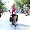 Record-Eagle/Keith King<br /> Kathryn Fluehr eyes the finish line in winning the women's 5K road race Saturday.