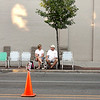 "Record-Eagle/Keith King<br /> Jan Watson, left, of Cadillac, and her husband, Don, sit along Union Street just after 7 a.m. in chairs that they set out for the Cherry Royale Parade scheduled for 11:15 a.m. The couple arrived at approximately 6:20 a.m. to secure the location. ""We're always the ones that come down here and put out the chairs,"" Don said about setting chairs out for others to join them later. ""We've had this spot for 20-something years,"" he continued. ""We came down here early one year and it was packed, so we've been coming earlier and earlier,"" Don said."