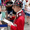 Record-Eagle/Keith King<br /> Mel Gee, a volunteer with the National Cherry Festival for 56 years, announces the DTE Energy Cherry Royale Parade on Saturday as it moves along Front Street.