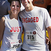Record-Eagle/Keith King<br /> Chicago's Katie Gustafson and Tim Jackson pose for a portrait Saturday after they ran in the Meijer Festival of Races 15K. Jackson had proposed to Gustafsonat sunset the night before on a beach in Elk Rapids.
