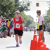 Record-Eagle/Keith King<br /> Lisa Taylor, right, Meijer Festival of Races director, gives encouragement to Denise Milne as she nears the finish line in the 15K Saturday.
