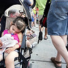 "Record-Eagle/Keith King<br /> Isabella Nestle, 2, of Port Huron, sleeps in her stroller on a sidewalk along Union Street. ""She got tired out; the parade was too much for her,"" mother Jamie Nestle said."