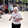 Record-Eagle/Keith King<br /> Gloria Veltman, 67, of Traverse City, finishes the 5K Saturday on Front Street.
