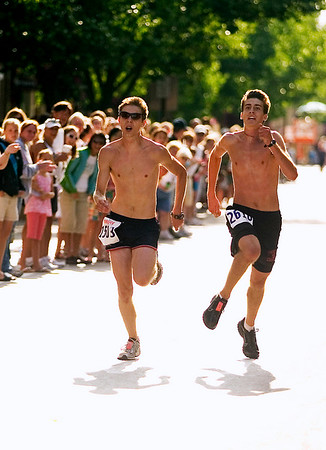 Record-Eagle/Jan-Michael Stump<br /> Blake Rottschafer, 19, right, of Spring Lake, edged Darryl Sluka, 18, of Casnovia by 1 second in the 15k in Saturday's National Cherry Festival Meijer Festival of Races.