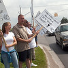Record-Eagle/Douglas Tesner<br /> Melissa Schichtel, a corrections officer at Pugsley Correctional Facility, and other corrections officers inform drivers at the intersection of South Airport Road and Division Street in Traverse City, that the state is releasing more than 4,000 prisoners and closing eight facilities by Oct. 1. The corrections officers believe the releases and closings put the public in danger.