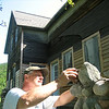 Record-Eagle/Art Bukowski<br /> Tom Kleinfelter works on the porch of the historic Martin Basch house in Sleeping Bear Dunes National Lakeshore.