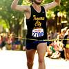 Record-Eagle/Jan-Michael Stump<br /> Festival of Races 5k men's winner Jake Secor of Traverse City crosses the finish line.