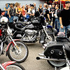 Record-Eagle/Keith King<br /> Motorcyclists mingle outside of Classic Motor Sports in Traverse City on Sunday as they wait for the start of the 2010 Ride for Father Fred sponsored by the Northern Chapter Harley Owners Group (HOG).
