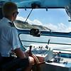 Record-Eagle/Marta Hepler Drahos<br /> Senior deckhand Bronson Flint, a senior at Benzie Central High School, steers the Sleeping Bear Dunes cruise boat.