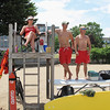 Record-Eagle/Vanessa McCray<br /> Lifeguards Danielle Beaudoin, left, David Sattler and Sean Seekins keep watch over Clinch Park Beach in Traverse City on a hot July day.