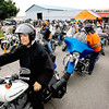 Record-Eagle/Keith King<br /> Father Iakovos Olechnowicz gets ready outside of Classic Motor Sports on Sunday. Father Olechnowicz, the current chaplin at the Father Fred Foundation, lead the riders.