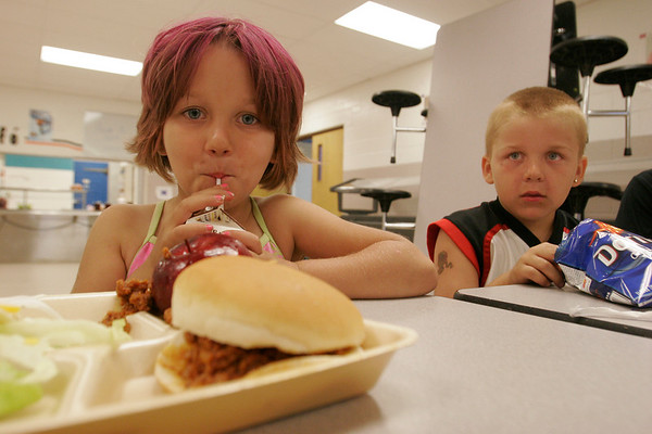 Record-Eagle/Douglas Tesner<br /> Braelyn Hanna, 5, and her brother Sam, 7, take part in the Kingsley Area Schools food service program that offers free lunch at the Kingsley Middle School cafeteria this summer.