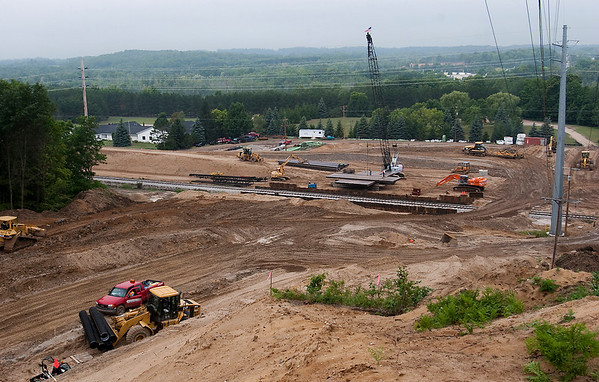 Record-Eagle/Douglas Tesner<br /> Construction crews work on the Hammond Road extension in Grand Traverse County.
