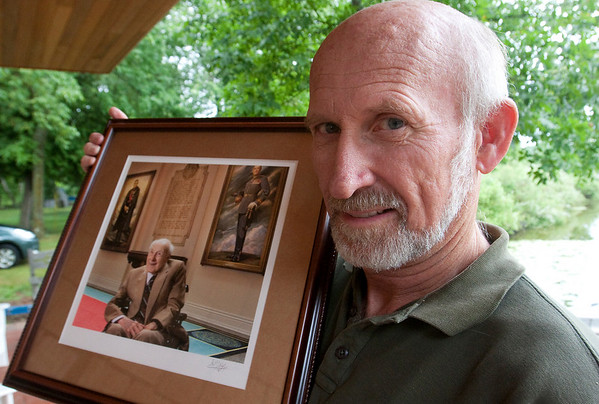 Record-Eagle/Douglas Tesner<br /> David Gray holds a picture of his grandfather, Henry Allingham.