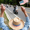 Record-Eagle/Douglas Tesner<br /> Hundreds of people line the route and greet bikers as they take part in the annual Father Fred ride.