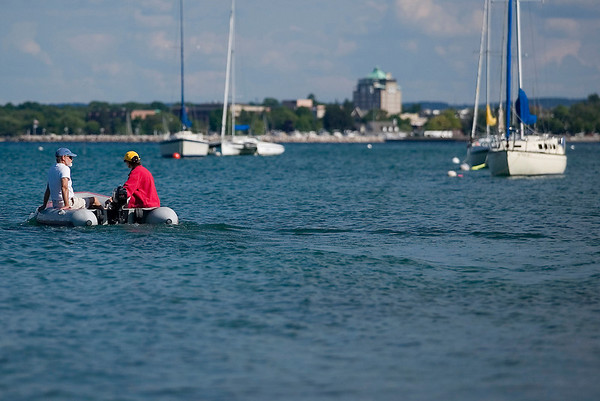 Record-Eagle photo/Jan-Michael Stump<br /> Diane Hubert and Richard Sutton ride to their sailboat at the Grand Traverse Yacht Club for a Monday evening sail on Grand Traverse Bay, which has seen increasing water levels over the last year along with other Great Lakes.