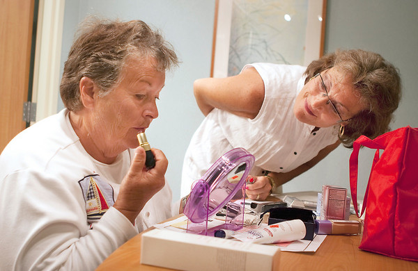 Record-Eagle/Douglas Tesner<br /> Judy Blandin gives Donna Daciuk, a cancer patient, advice on cosmetics.