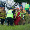 Record-Eagle photo/Jan-Michael Stump<br /> Rescuers use the Jaws of Life to extract the driver of an overturned 2005 Honda Odyssey, above, after it collided head-on with a 2006 Lincoln Towncar on M-72, west of Bugai Road on Tuesday afternoon. Each vehicle contained one male occupant, said Cedar Fire Chief Dan Petroskey. Both drivers were taken to Munson Medical Center, he said, but their conditions are unknown. The Grand Traverse County Sheriff's Department is handling the investigation.
