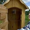 Record-Eagle/Keith King<br /> Bill Councell, of Lake Ann, describes an outhouse he built using red pine with the roof being made of cedar. The outhouses are primarily used for storage.